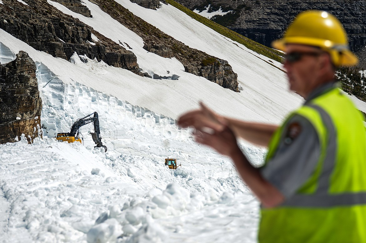 Glacier National Park Road Supervisor Brian Paul answers questions as road crews clear snow at the Big Drift along the Going-to-the-Sun Road on Wednesday, June 2, 2021. (Casey Kreider/Daily Inter Lake)