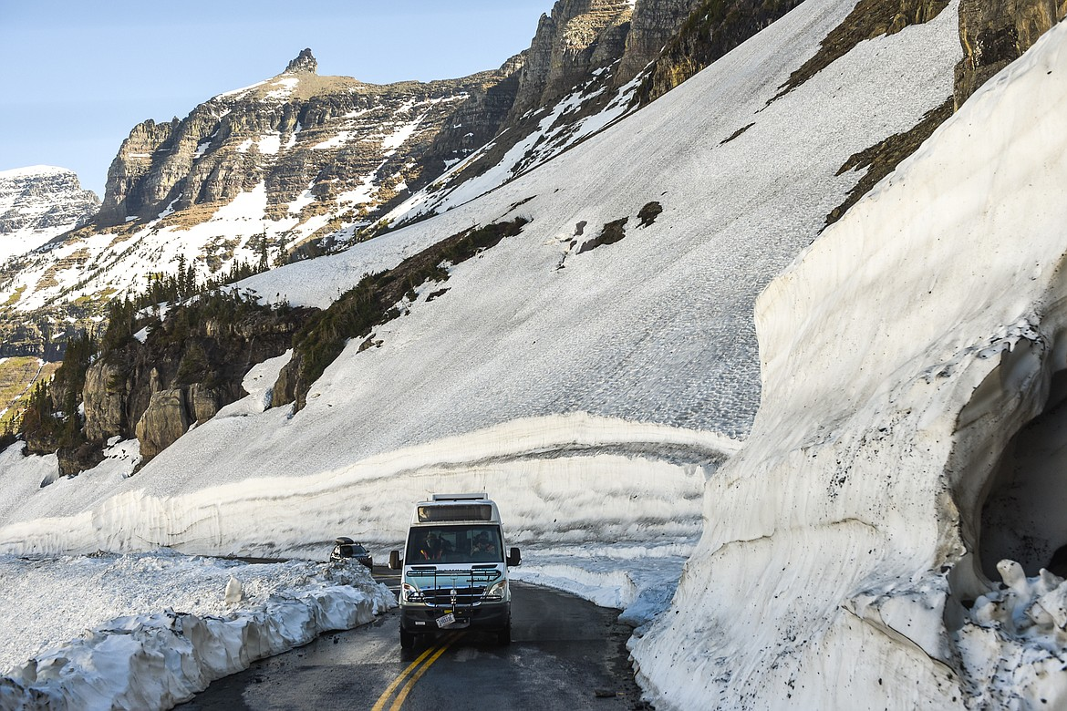 A Glacier National Park shuttle bus makes its way along the Going-to-the-Sun Road during a media tour of the snow removal process at Logan Pass on Wednesday, June 2, 2021. (Casey Kreider/Daily Inter Lake)