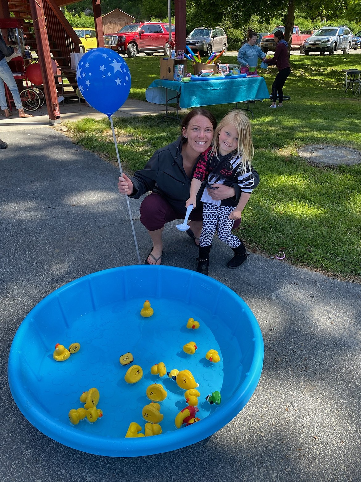 Families played a duck game at the event hosted by Hope Preschool, along with painting rocks and other activities.