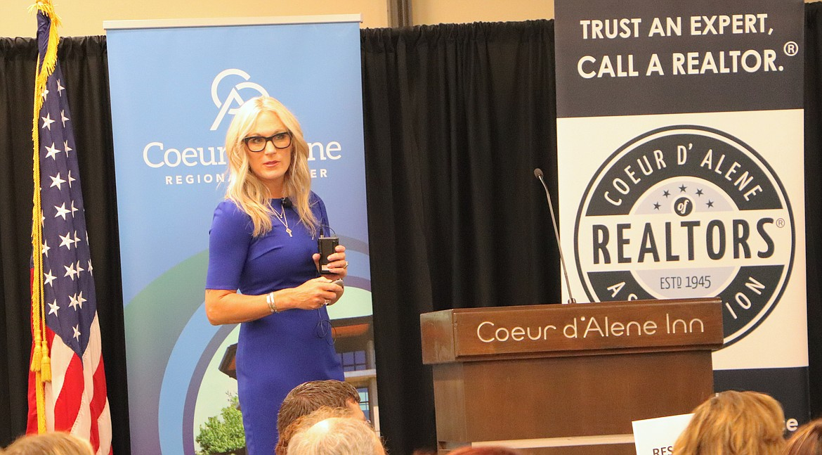 """Jennifer Smock of Windermere / Coeur d'Alene Realty, Inc. gave attendees at the """"Navigating the Wild Wild West - the Growth of Kootenai County"""" hard facts on developments in the real estate industry. Photo courtesy the Coeur d'Alene Regional Chamber of Commerce."""