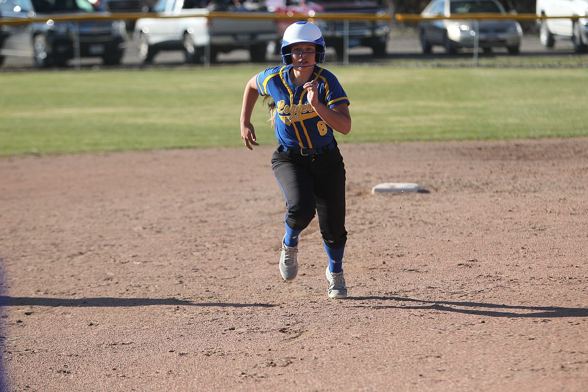 Kinzee Boehmler runs for third base during an April Lady Loggers game. (Will Langhorne/The Western News)