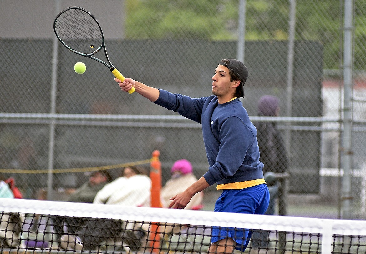 Michael Hollingsworth hits a volley in a closely contested match against Ronan's Beau Decker at the Western A Divisional Tennis Tournament in Polson on Friday. (Whitney England/Whitefish Pilot)