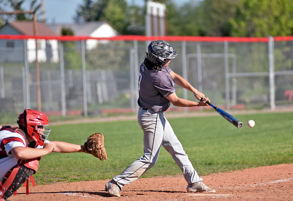 Glacier Twins' Taylor Bryan connects with a ball for a hit during a game against the Kalispell Lakers A on Wednesday, June 2 in Kalispell. (Whitney England/Whitefish Pilot)