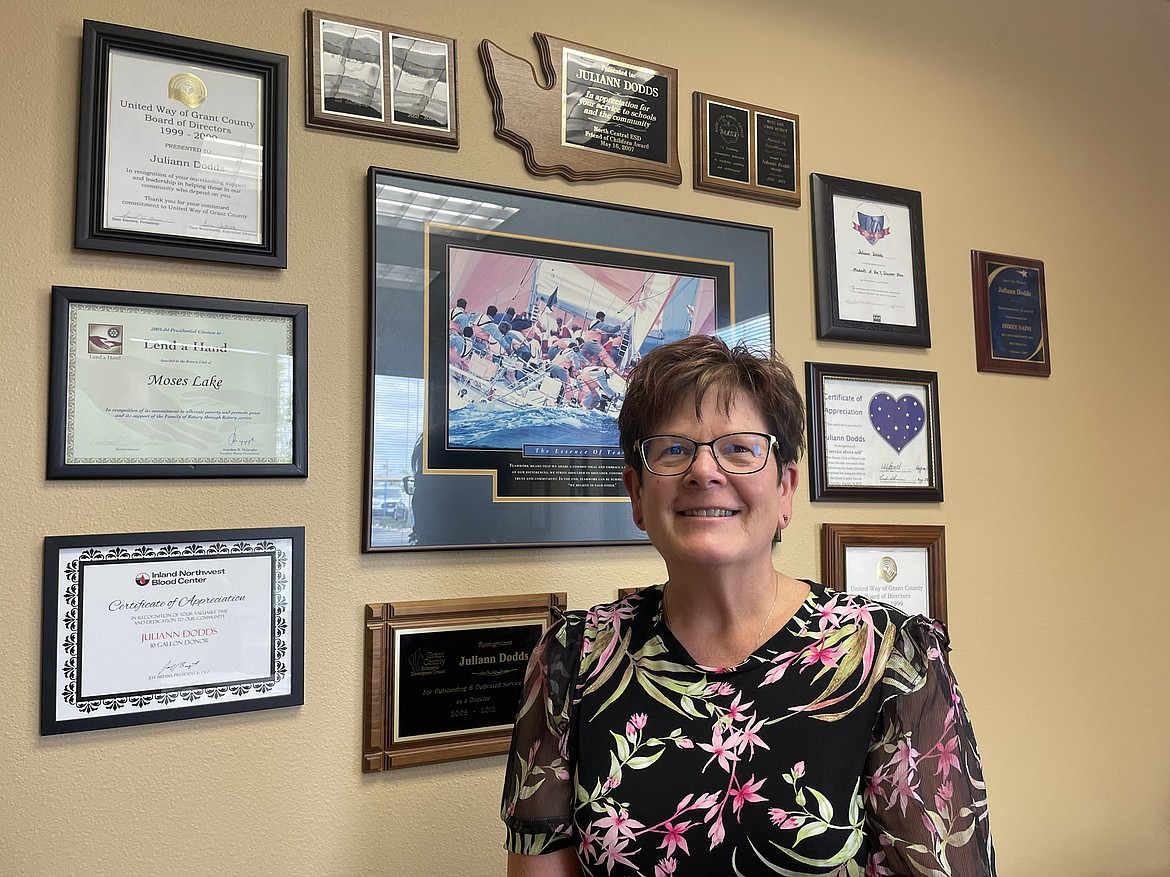 Juliann Dodds, senior Vice President and commercial banking manager for Banner Bank in Moses Lake, with some of the many awards and community recognition certificates she has received over the years. Dodds is a current board member and former president of the Grant County Economic Development Council.