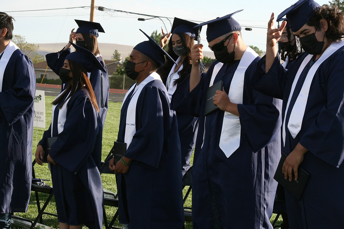 Desert Oasis High School graduates turn the tassel at the end of the ceremony June 7 in Othello.