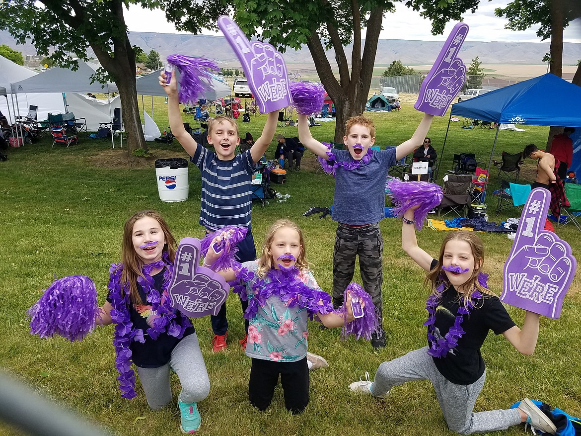 A group of five kids cheer on the Sharks during the first meet of the season in Lewiston. Back row (from left): Eli Norling and Olli Leavitt. Front row (from left): London Leavitt, Claire Ballard and Allyson Ballard.