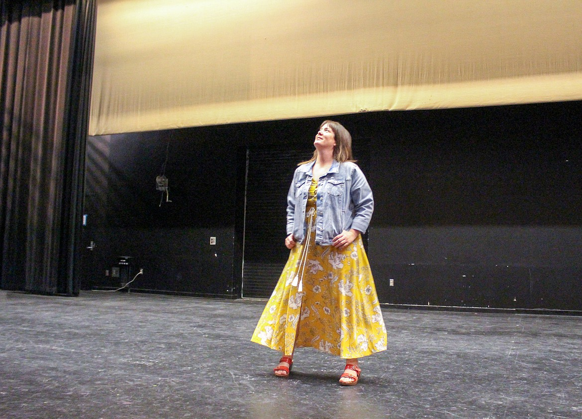 Moses Lake High School drama adviser Sharon Winningham looks around the empty stage in the high school theater as her first year with the program comes to an end.