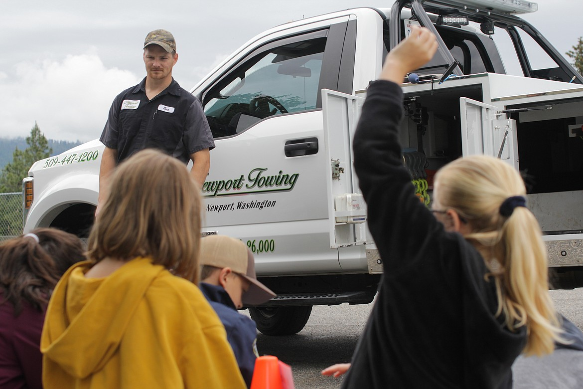 Gus Riley with Newport Towing gives a safety presentation to students and shows them how his tow truck works Wednesday at Idaho Hill Elementary.