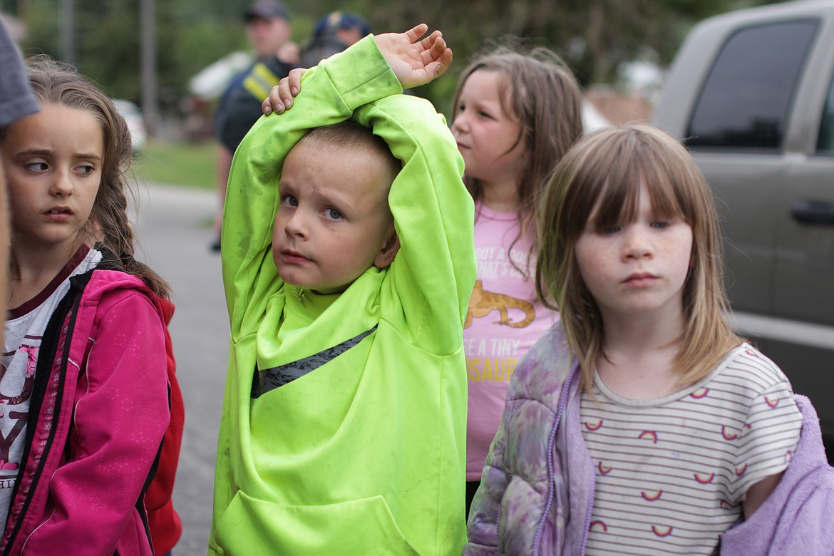 Students raise their hands to ask questions during safety demonstrations Wednesday at Idaho Hill Elementary.