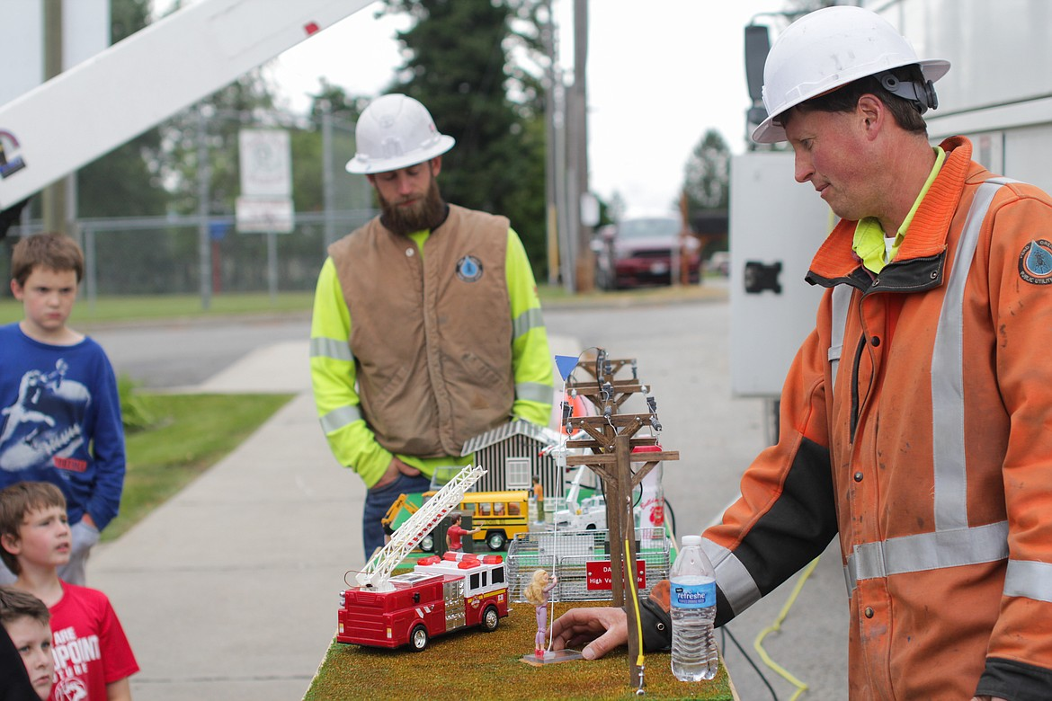 Tree trimmer Bronson Gerstenberger (left) and lineman James Huling with the Pend Oreille Utility District give a presentation on electrical safety Wednesday at Idaho Hill Elementary.