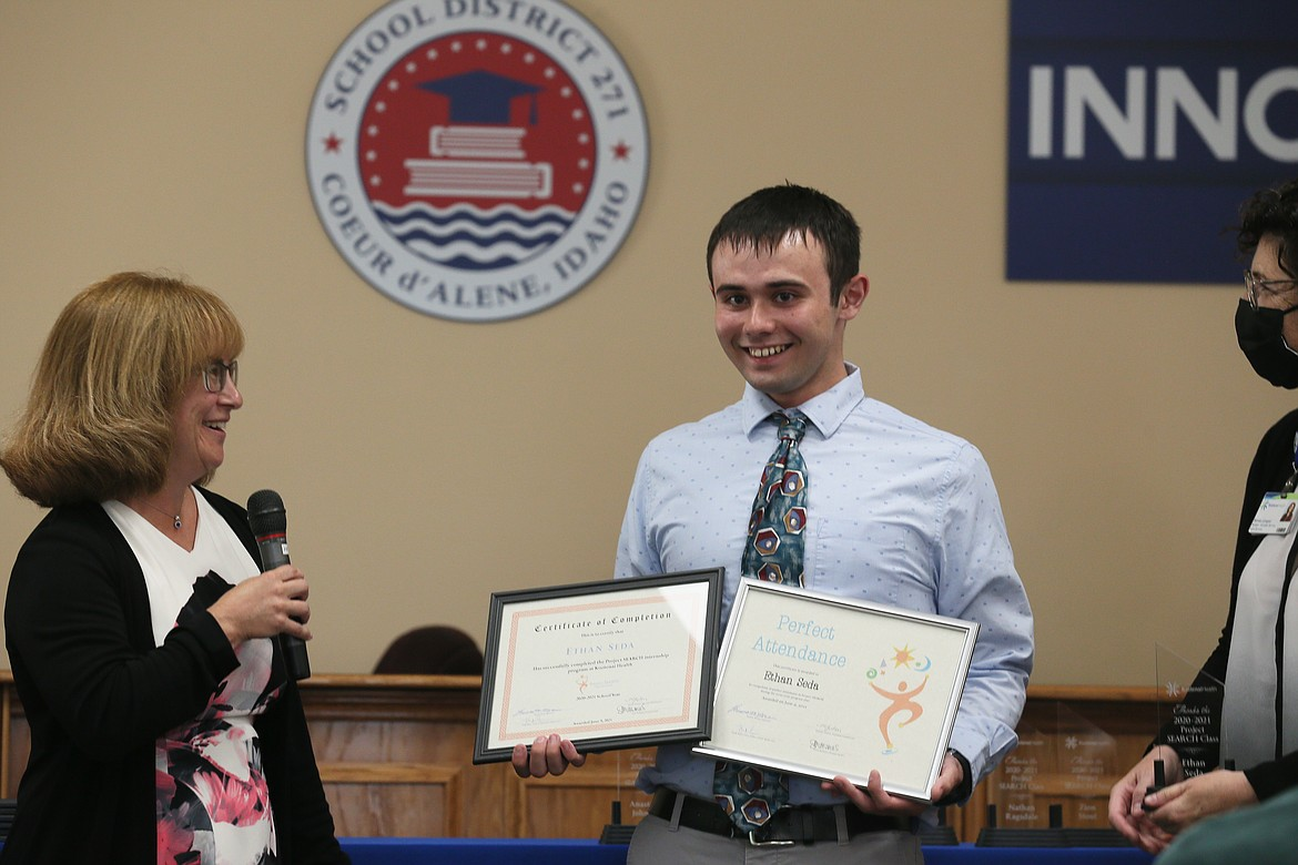 Project SEARCH grad Ethan Seda is all smiles as he receives his certificate of completion and an award for perfect attendance during the graduation celebration Wednesday. Also pictured: Project SEARCH instructor Theresa Moran, left, and Kootenai Health business liaison Renee Langue.