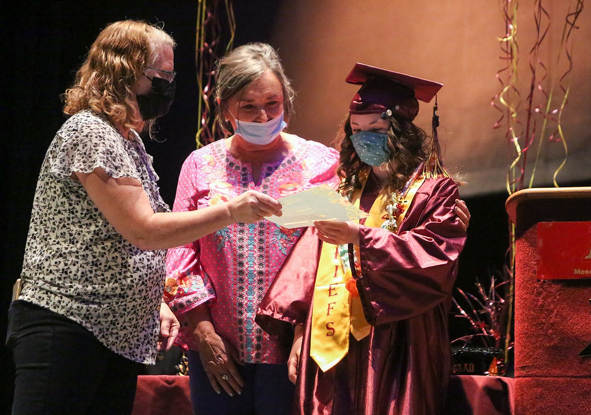 Left to right, Denise Ketola and Pam Hare with the Down Syndrome Society of Grant County award Kailee Truman the Natasha Hastings Memorial scholarship fund at the graduation ceremony on Wednesday afternoon at Moses Lake High School.