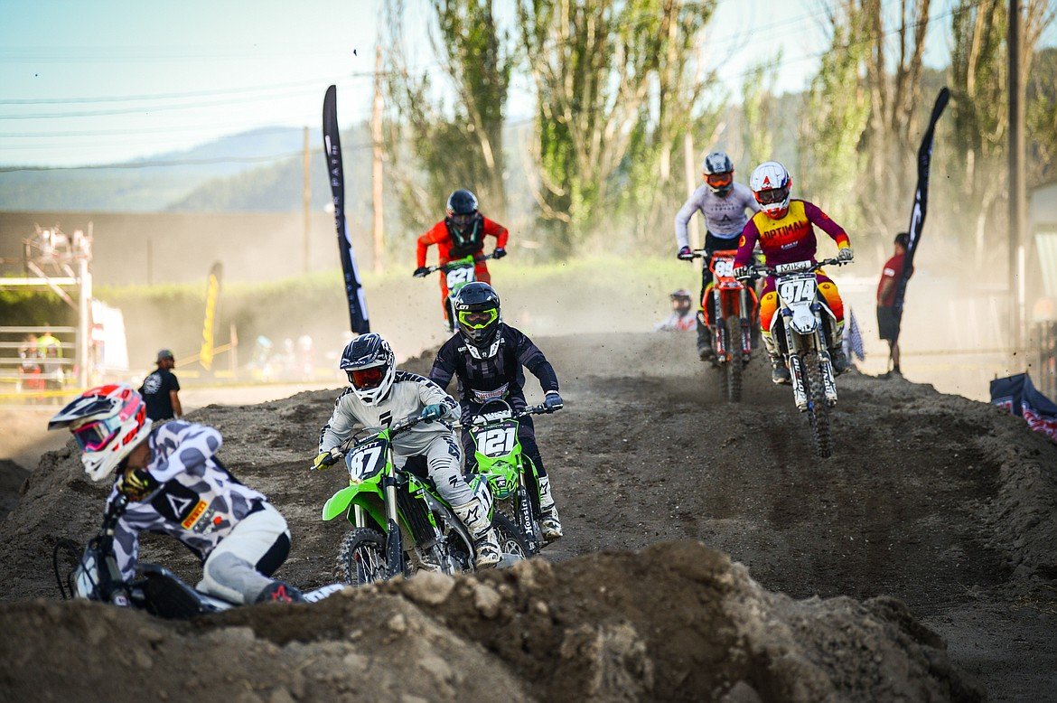 Professional riders race during Top Dawg Arena Cross at the Northwest Montana Fairgrounds in Kalispell on Friday, June 18, 2021. (Casey Kreider/Daily Inter Lake)