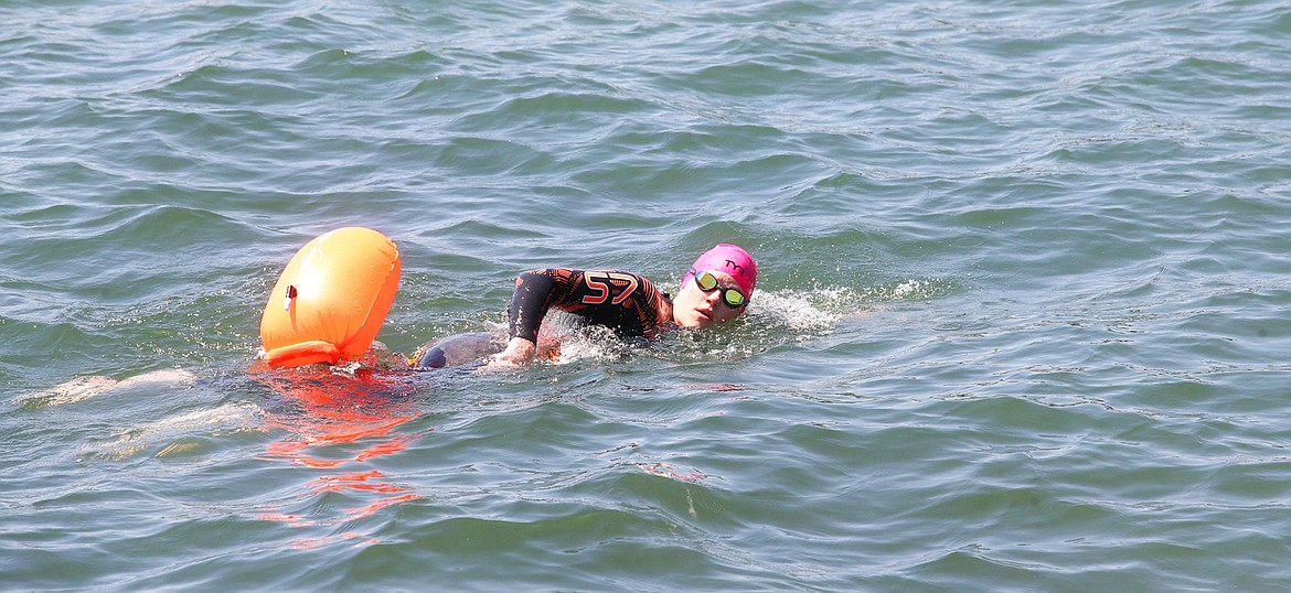 Megan Ivers swims in Lake Coeur d'Alene just off Independence Point on Tuesday in preparation for Sunday's Ironman Coeur d'Alene.