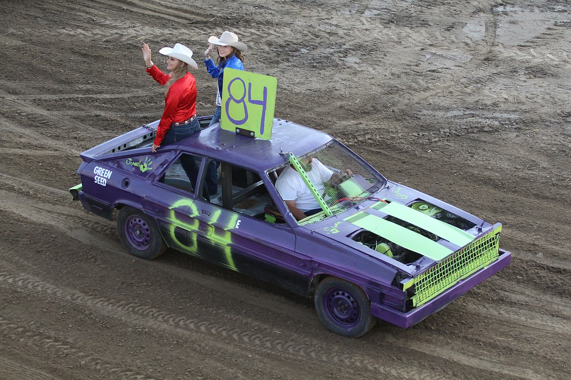 Sun Tribune No. 84, with rodeo queens aboard, makes its way around the track at the 2019 Othello Rodeo Demolition Derby.