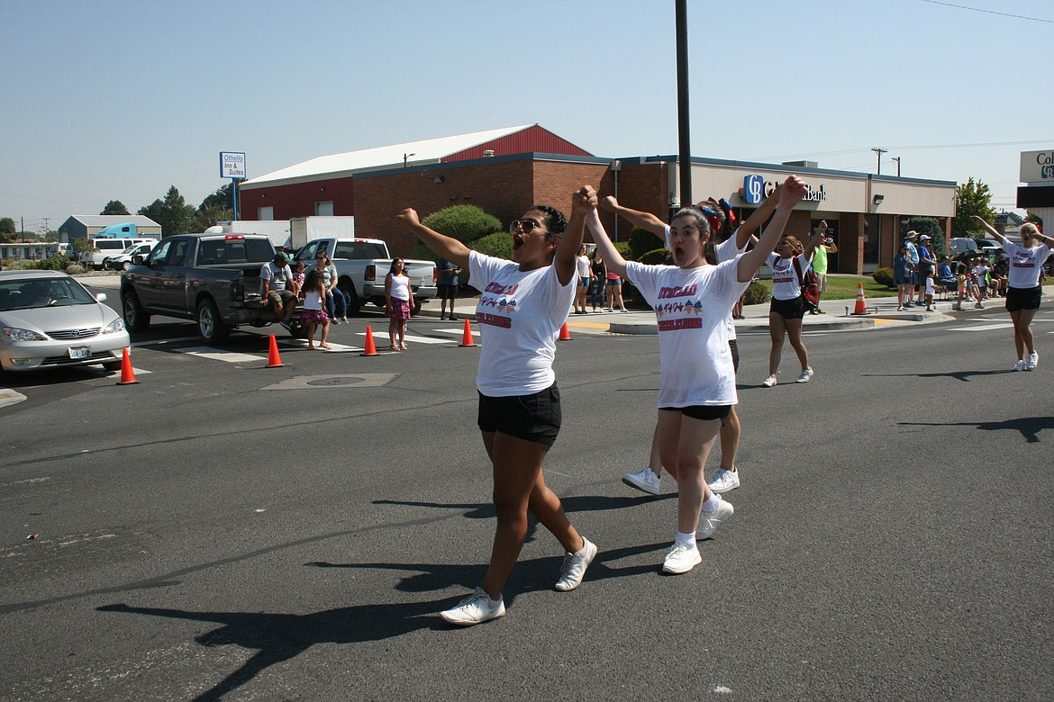 The Othello High School cheer squad leads a cheer during the Independence Day parade July 3 in Othello.