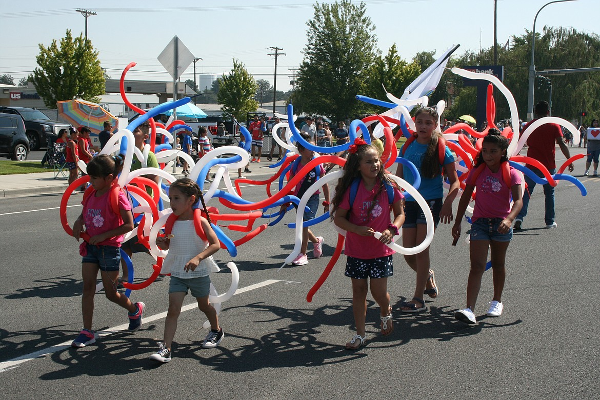 Members of an Othello group dressed up in patriotic balloons for the Independence Day parade in Othello July 3.
