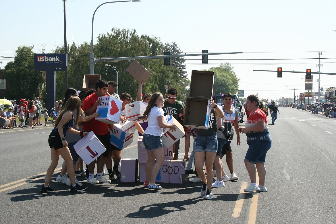 Members of an Othello church youth group disassemble the project they created for the Independence Day parade in Othello July 3.