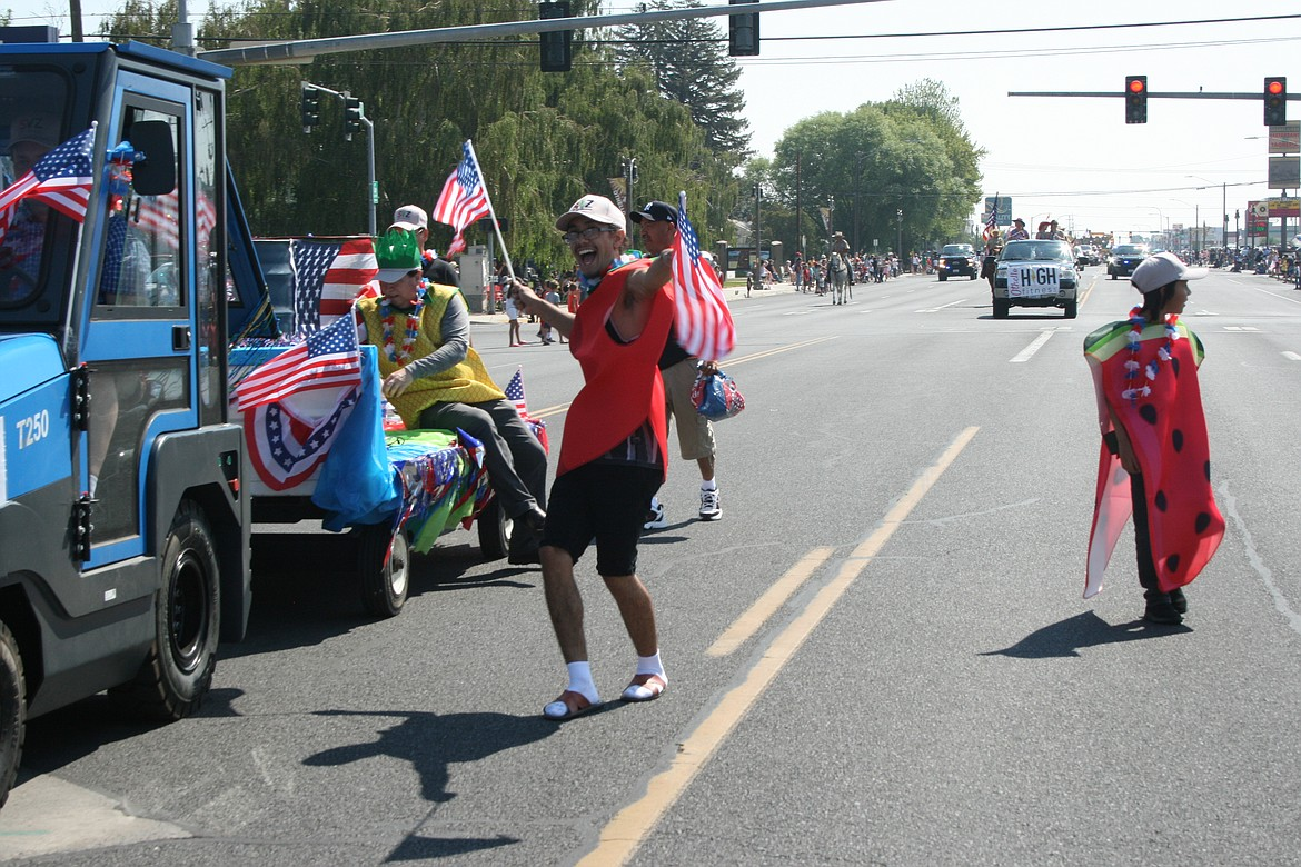 A parade participant puts his all into the Independence Day parade in Othello July 3