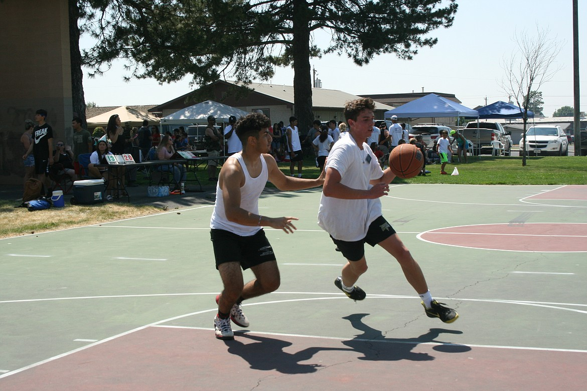A player drives to the basket during the three-on-three basketball tournament at the Independence Day celebration in Othello July 3.