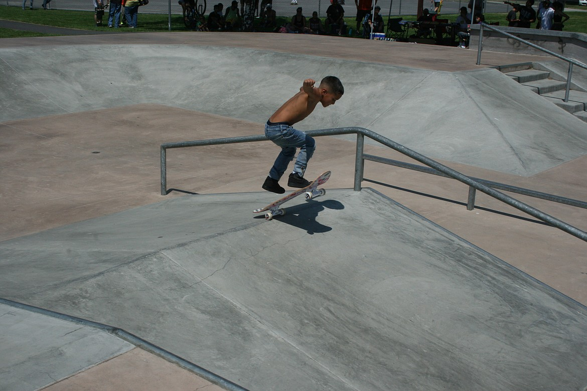Xander Pena, 6, of Othello, flips the skateboard during his first run at the skate tournament at the Independence Day celebration July 3 in Othello.