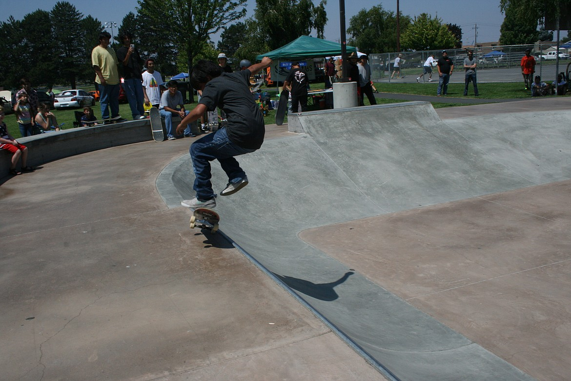 A competitor flips his board during skateboard competition July 3 at the Independence Day celebration in Othello.
