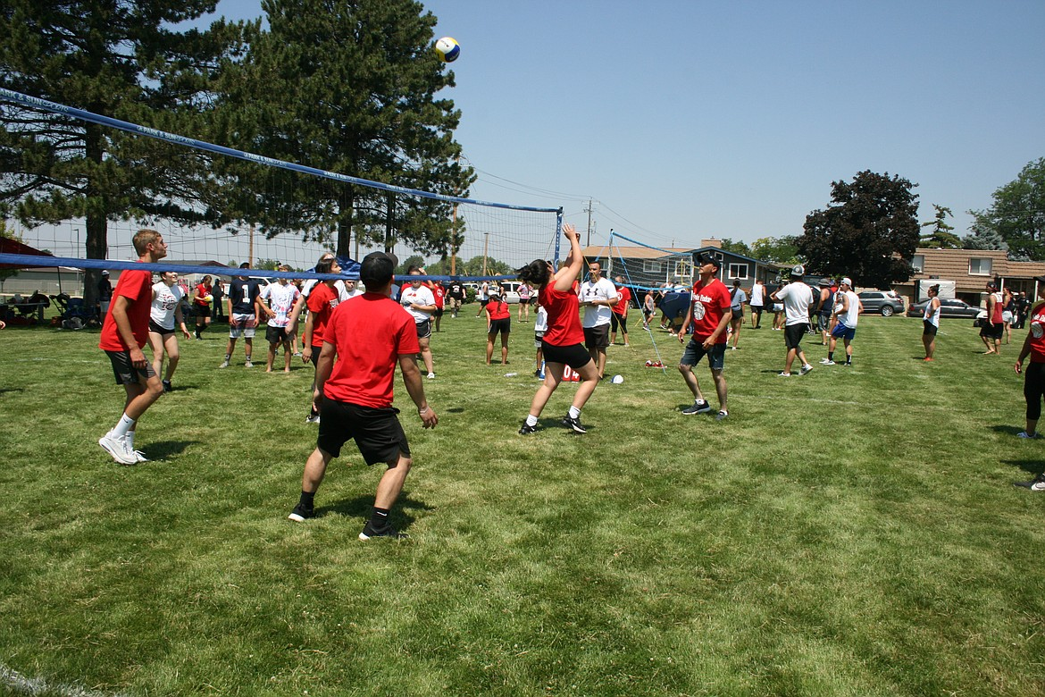 Volleyball players keep the ball in play during the tournament at the Independence Day celebration July 3 in Othello.