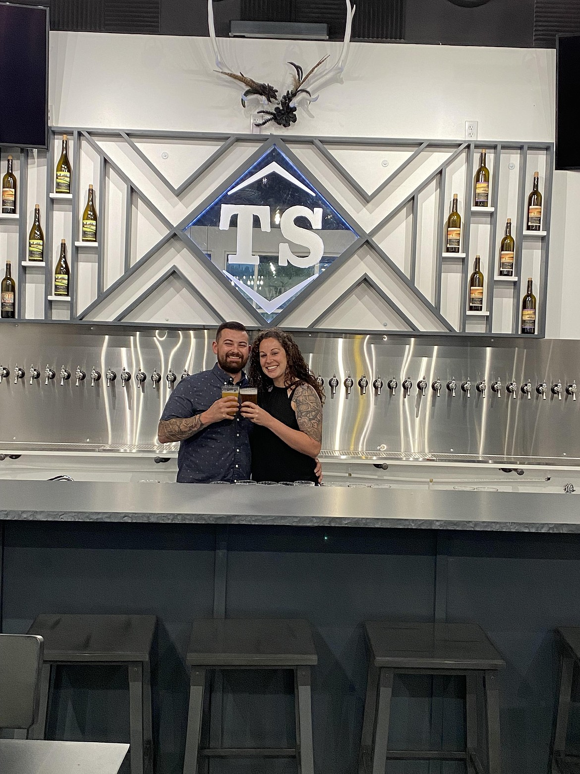Courtesy photo Owners Nick Giese and Tiffanie Delaney pose inside Twisted Slate Brewery, which has opened at 8160 N. Cornerstone Drive in Hayden.