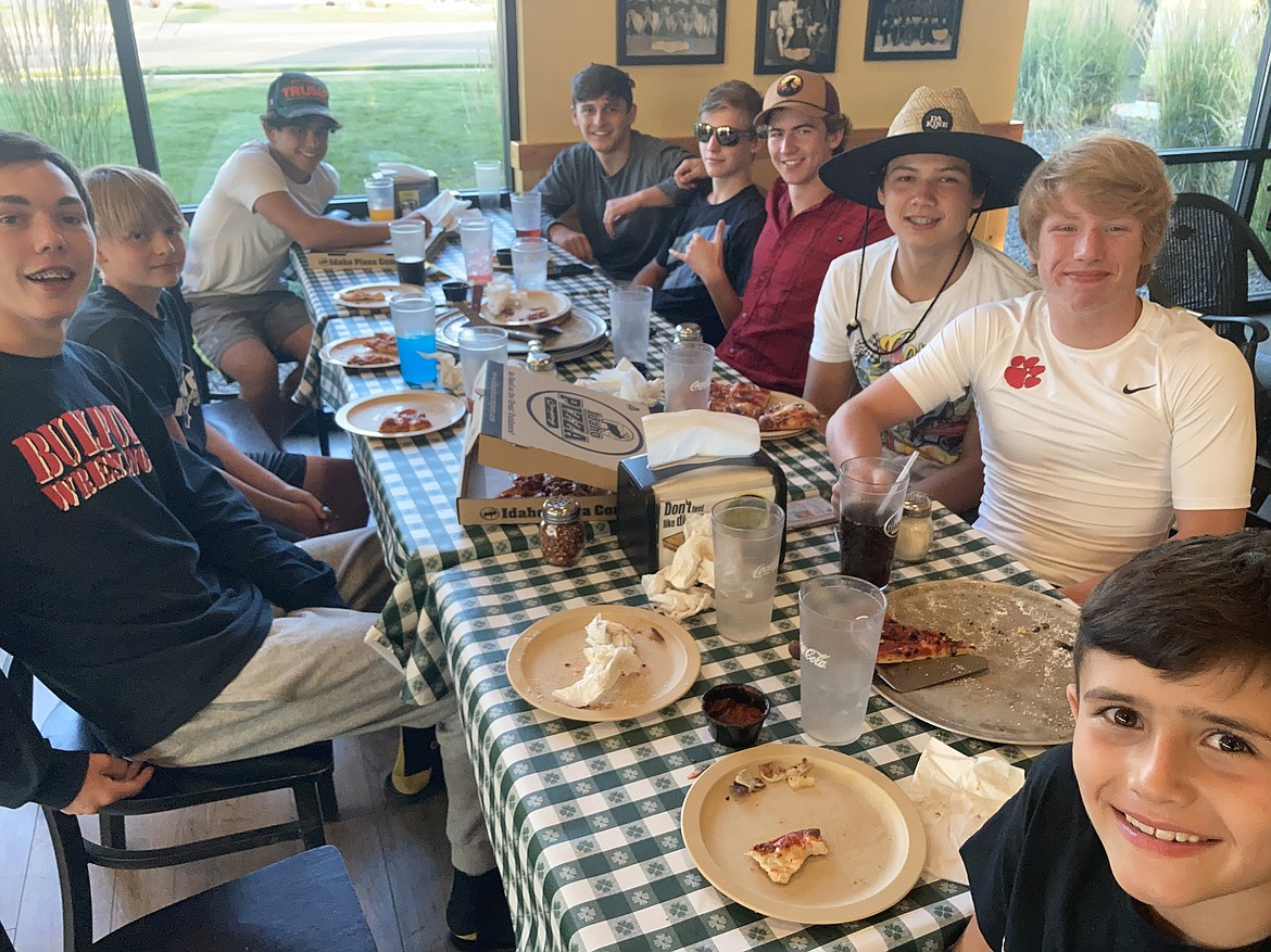 Bulldogs enjoy a team meal during the Wildcat Wrestling Camp last week in Nampa.