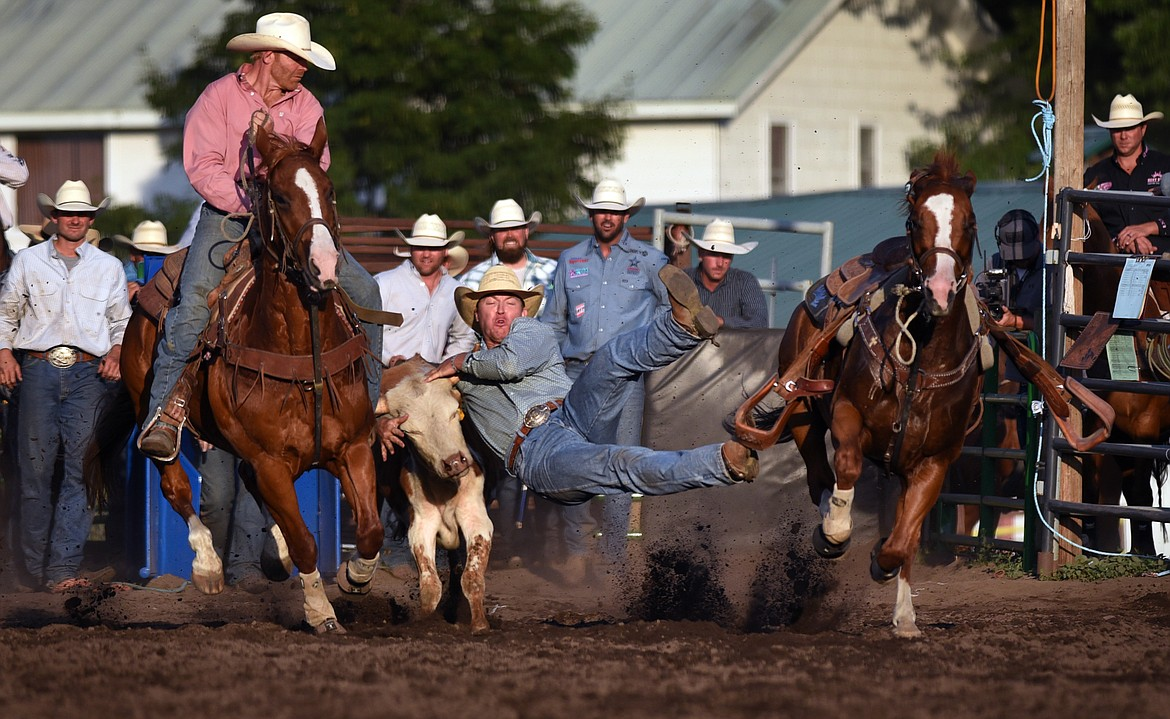 Hayden Ray Fullerton of Dayton, Washington grab a hold of his draw during the steer wrestling section of the the Bigfork Summer Rodeo Wednesday July 7, 2021. (Jeremy Weber/Bigfork Eagle)