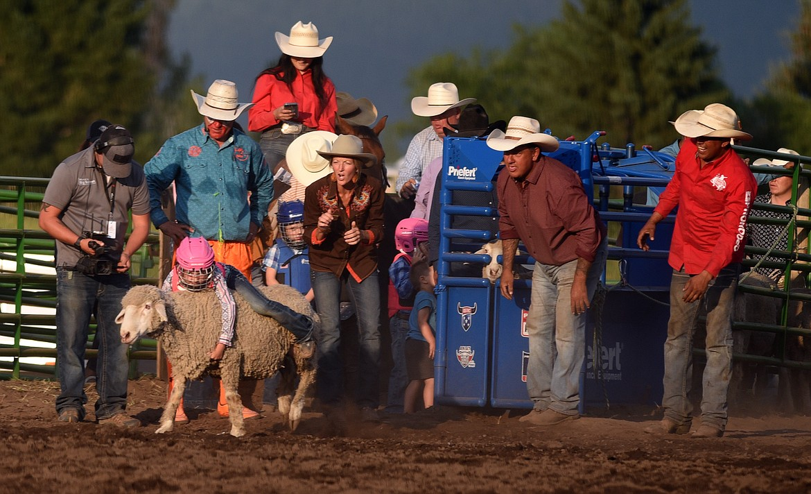 A young competitor takes her turn during mutton busting at Bigfork Summer Rodeo Wednesday July 7, 2021. (Jeremy Weber/Bigfork Eagle)