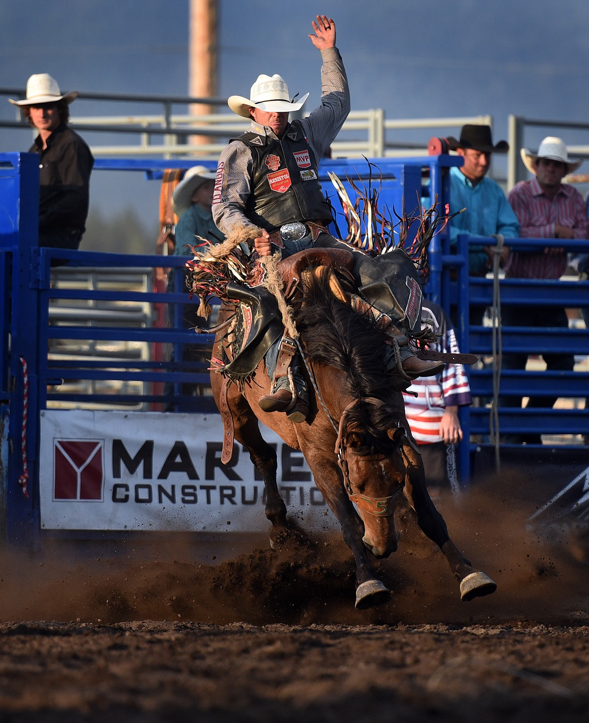 Layton Green of Meeting Creek, Alberta, Canada holds on tight during saddle bronc action at the Bigfork Summer Rodeo Wednesday July 7, 2021. (Jeremy Weber/Bigfork Eagle)