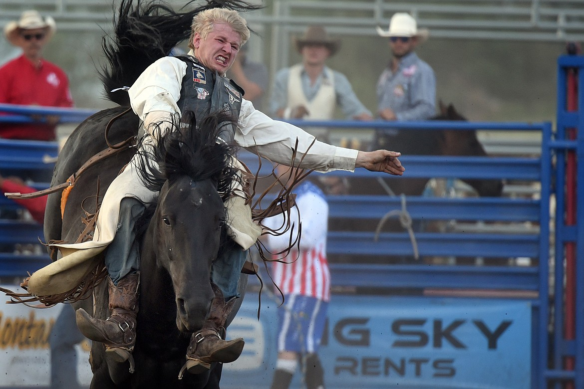 Anthony Thomas of Houston, Texas fights to make eight seconds on top of Dolly's Card Shark during bareback riding action at the Bigfork Summer Rodeo Wednesday, July 7, 2021. (Jeremy Weber/Bigfork Eagle)