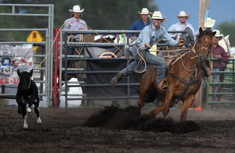 Travis James Eller of Colville, Washington dismounts his horse during tie down roping action at the Bigfork Summer Rodeo Wednesday July 7, 2021. (Jeremy Weber/Bigfork Eagle)