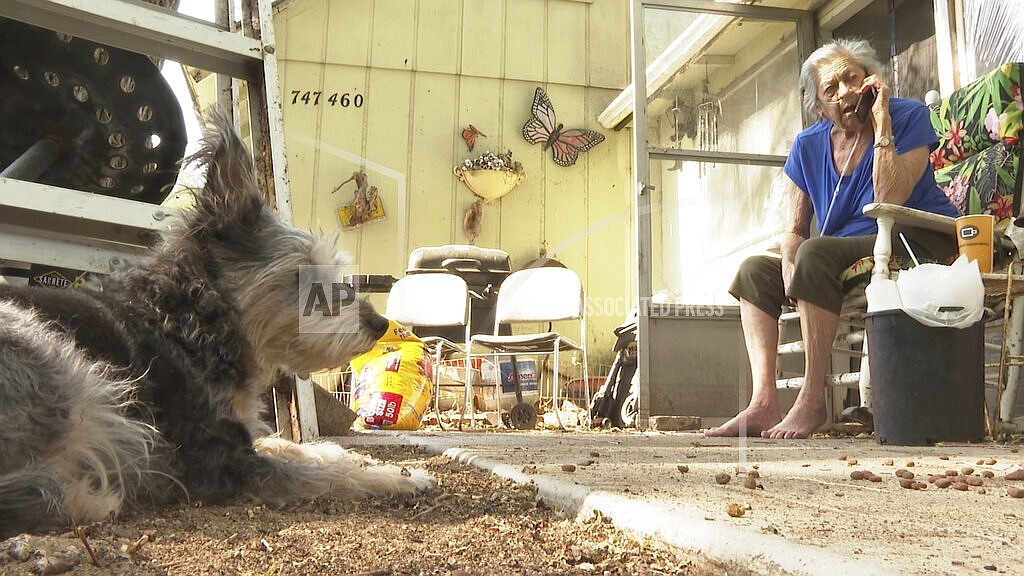 """Beverly Houdyshell, 79, who's home burned down, sits at her granddaughter's house in Doyle, Calif. on Tuesday, July 13, 2021. Houdyshell, said Tuesday that she's too old and too poor to rebuild and isn't sure what her future holds. """"What chance do I have to build another house, to have another home?"""" Houdyshell said. """"No chance at all."""" Damage was still being tallied in the rural community of Doyle, Calif., where flames swept in during the weekend and destroyed several homes, including Houdyshell's. (AP Photo/Haven Daley, File)"""