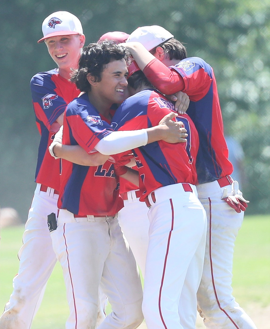 The Lakers swarm Zach Leverich to celebrate his walk-off hit on Friday.