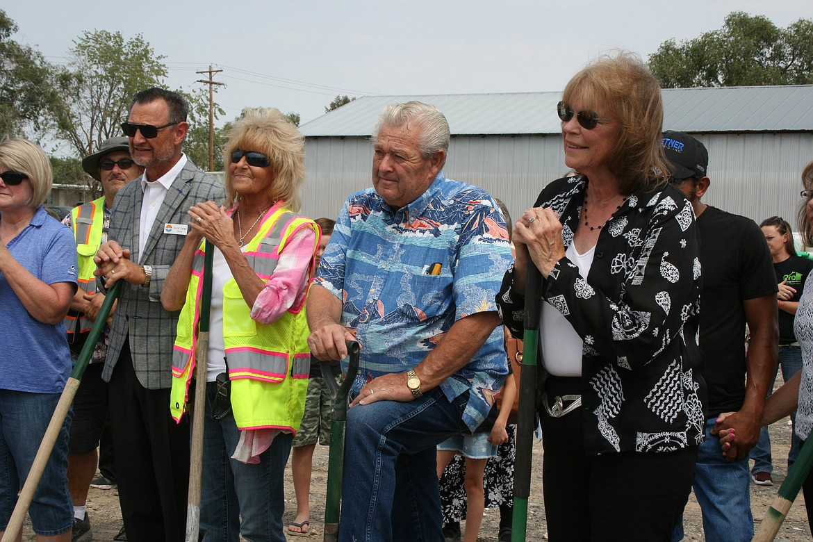 From the left: Moses Lake Mayor David Curnel, Moses Lake Food Bank Director Peny Archer, Mick Hansen and Sen. Judy Warnick, R-Moses Lake, listen to a speech during groundbreaking ceremonies for the new food bank Monday.