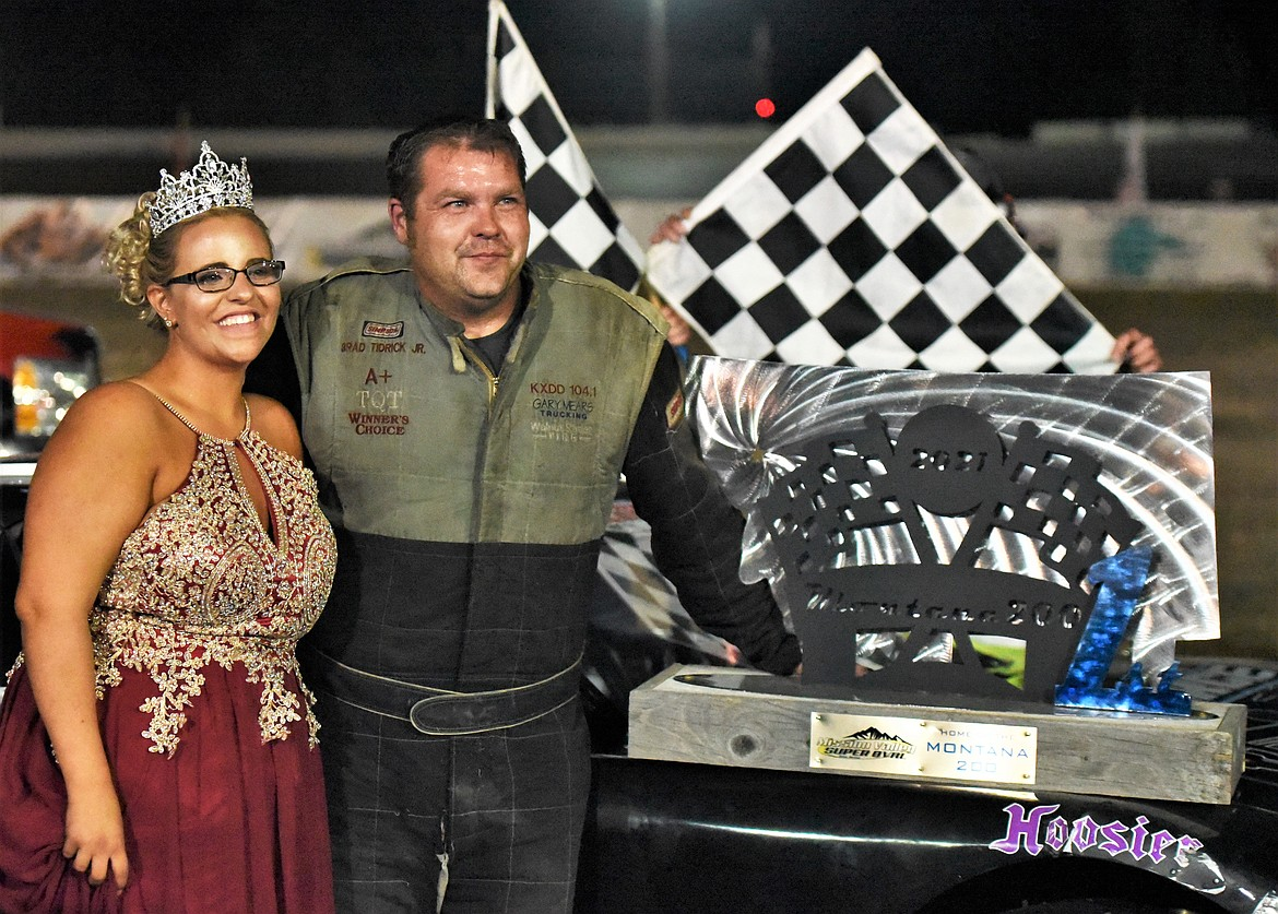 BJ Tidrick poses with Montana 200 Trophy Queen Dallas Dull of Columbia Falls after his win Saturday. Tidrick also won the 2005 Montana 200 in Kalispell. (Scot Heisel/Lake County Leader)