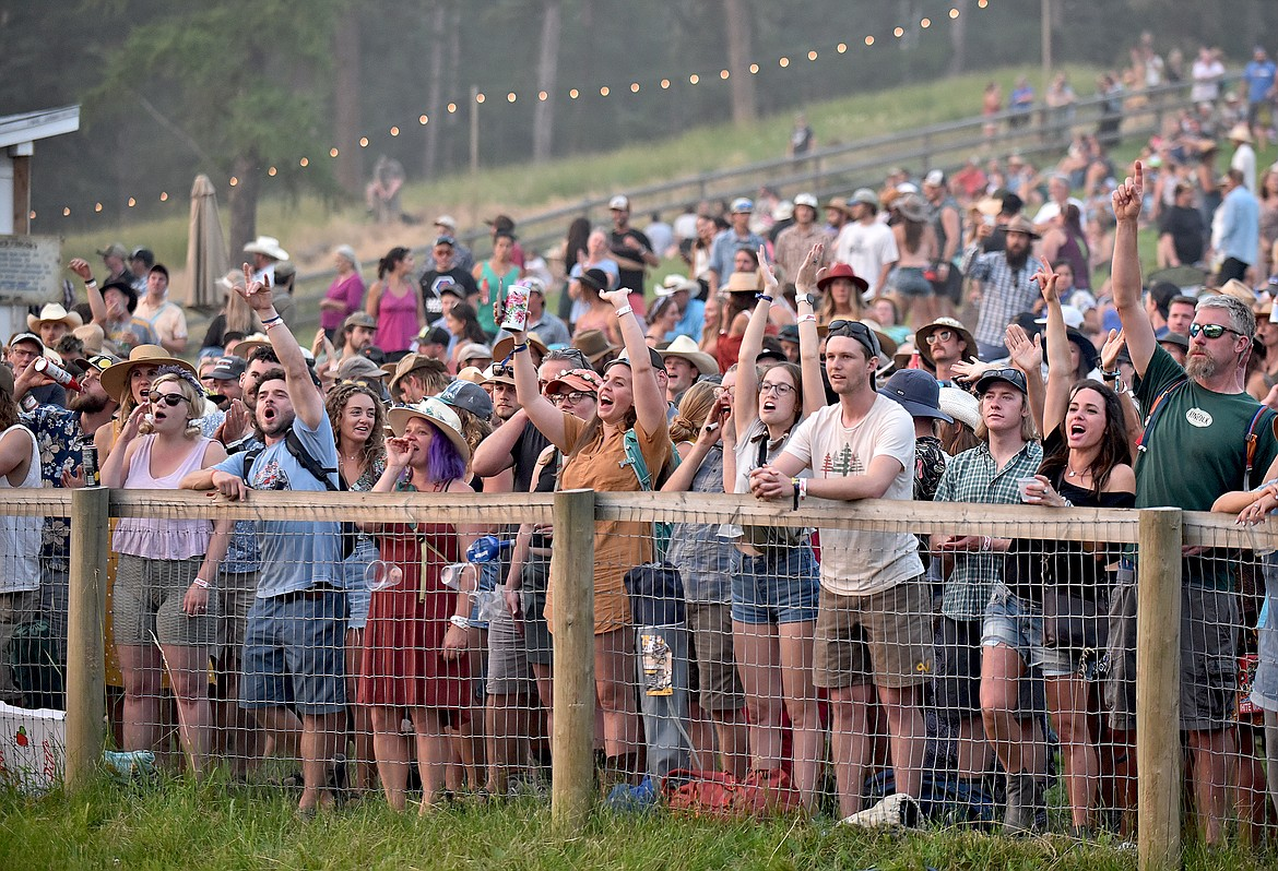 Fans cheer along the front of Big Mountain Stage at the Under The Big Sky Festival in Whitefish on Saturday. (Whitney England/Whitefish Pilot)
