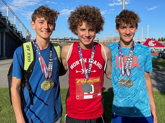 Courtesy photo Three local 14-year-old athletes qualified for the National Junior Olympic Championships in track and field. Max Cervi-Skinner, left, will compete with his brother Zack, right, in the 1,500- and 3,000-meter events, and Kyle Rohlinger, middle, will run in the 800-meter race. All three boys were coached for the national championships by Emry Carr, the head coach of North Idaho Cross Country, and several other local coaches contributed. The USATF events will be held July 26-Aug. 1 at the University of North Florida in Jacksonville, Fla.