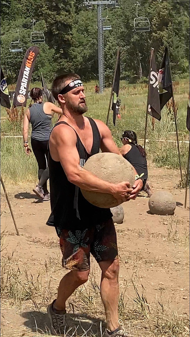 Ryan Nollan completes the Atlas Stone Carry obstacle in a Spartan Race. Courtesy photo