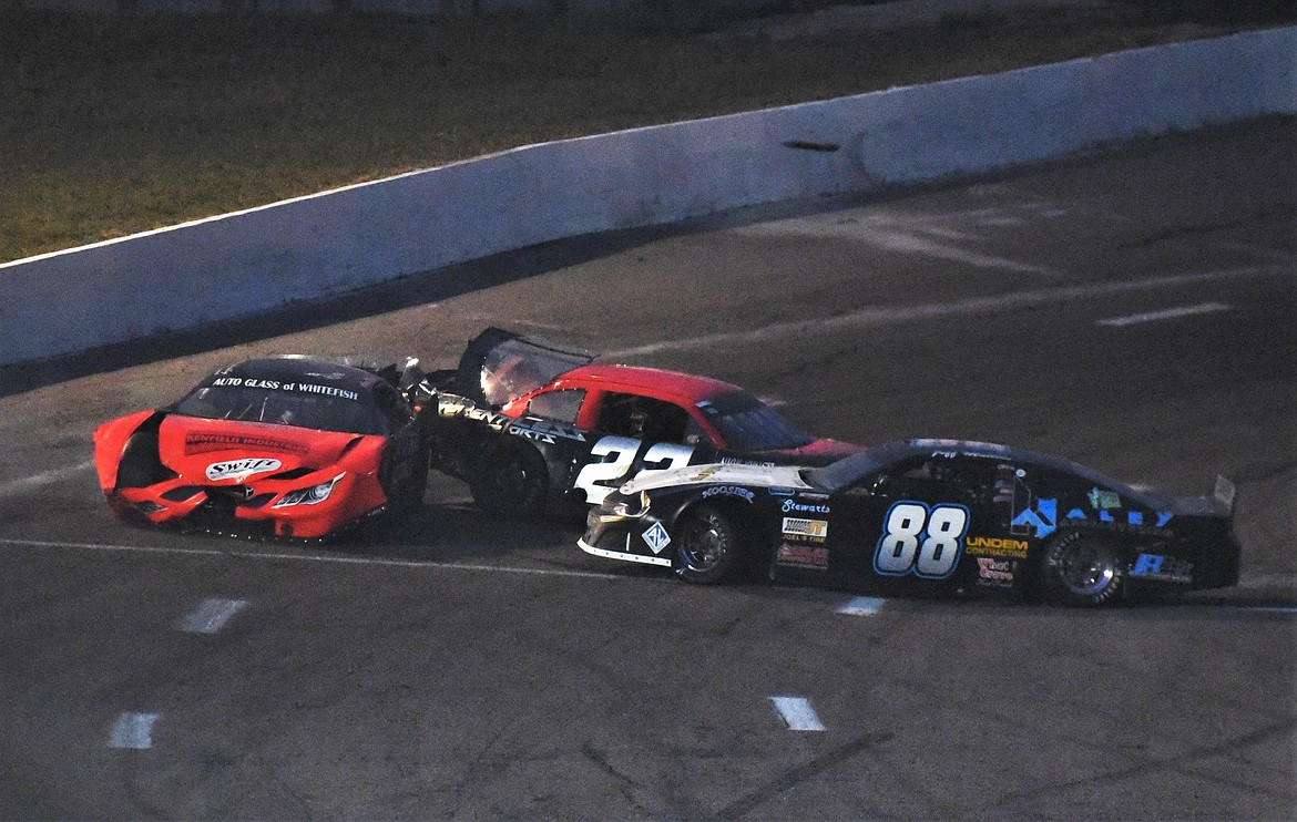 A crash in turn 4 on lap 71 knocked out Agni Howell of Kalispell, JD Undem of Frenchtown (22) and Jeff Mullins of Naches, Wash. (88). (Scot Heisel/Lake County Leader)