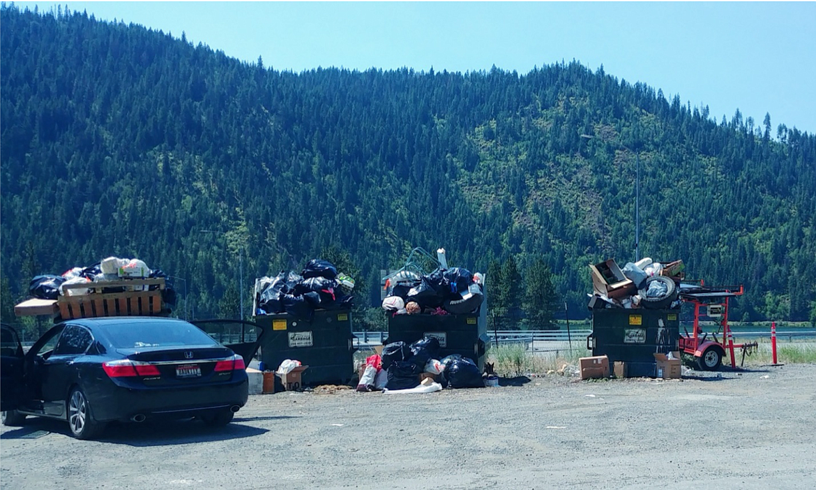Images from a resident near Wolf Lodge Bay shows a mounting pile of trash in front of the North Idaho tree line. Photo courtesy the Kootenai County Solid Waste Department.