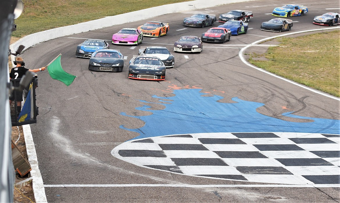 The green flag signals the start of the 2021 Montana 200 at Mission Valley Super Oval. (Scot Heisel/Lake County Leader)