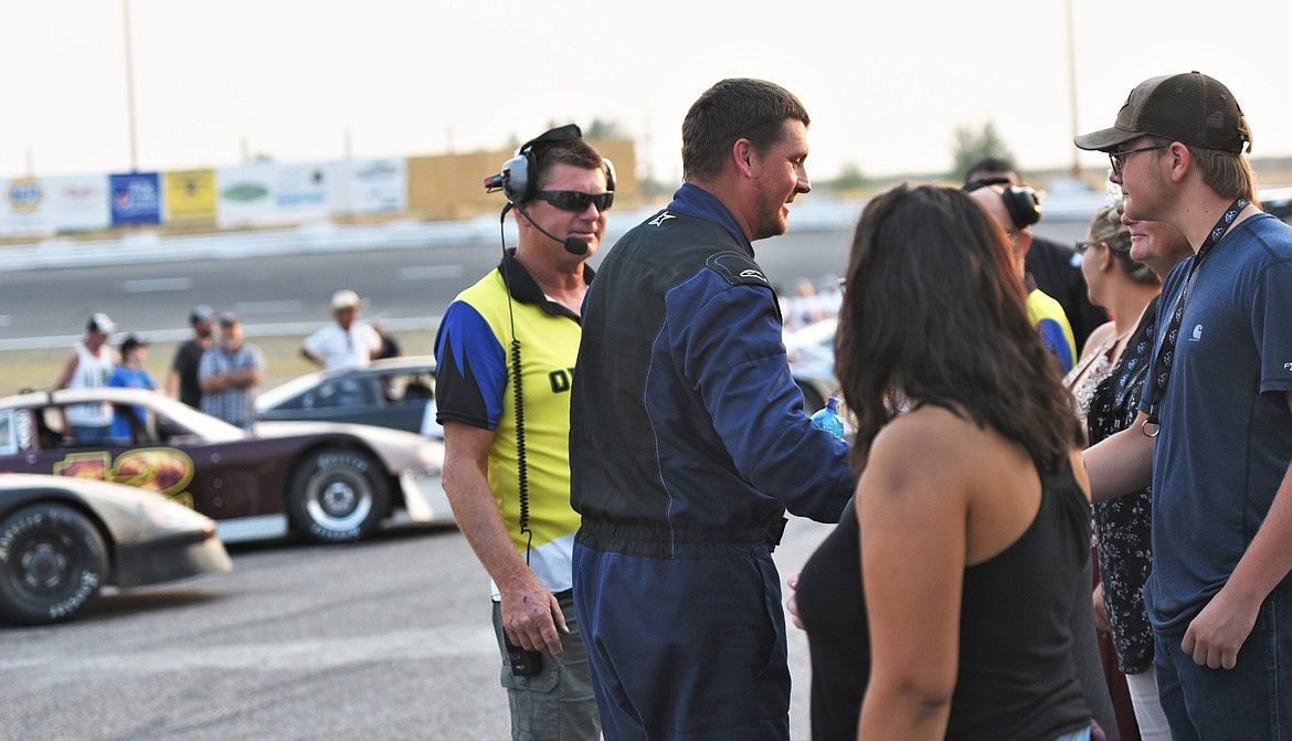 Driver Derek Undem shakes hands with sponsors and race officials in front of his father, track operator Tony Undem prior to the race. Derrick Undem finished seventh. His brother, JD, finished 13th. (Scot Heisel/Lake County Leader)