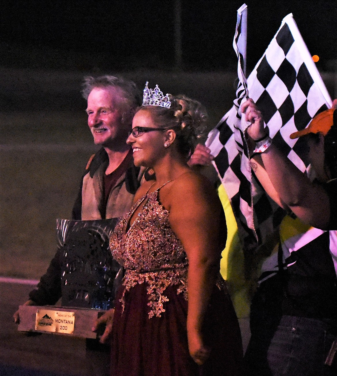 Ronan driver Cory Wolfe poses with Montana 200 Trophy Queen Dallas Dull of Columbia Falls after his third-place finish Saturday. Wolfe won the 1994 Montana 200 in Kalispell. (Scot Heisel/Lake County Leader)