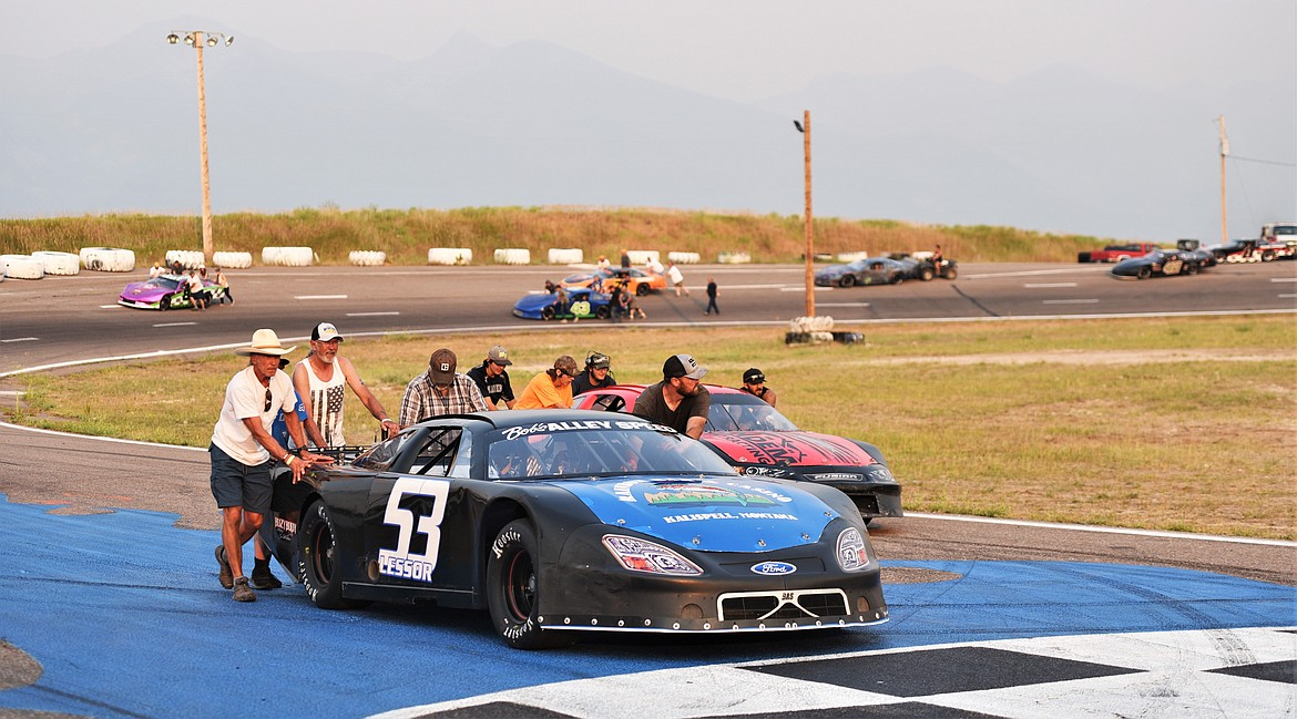 Alex Lessor's crew pushes his No. 53 car to the front of the track for the pre-race lineup. (Scot Heisel/Lake County Leader)
