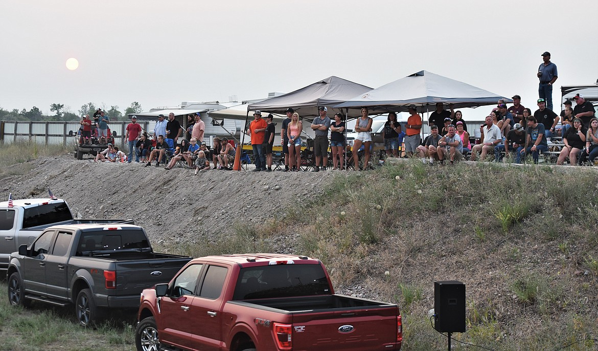 The crowd watches from the new bleachers west of the beer garden as the sun sets. (Scot Heisel/Lake County Leader)