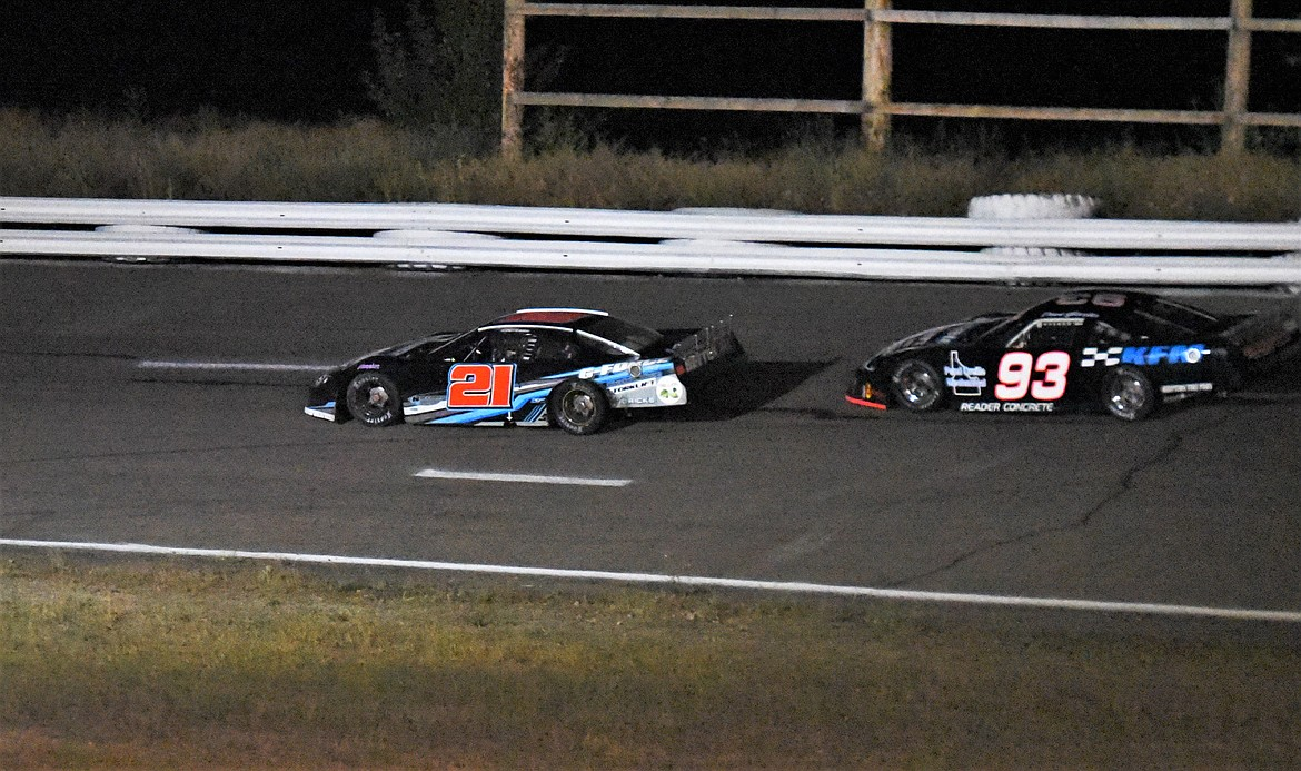 BJ Tidrick takes over the lead from Dave Garber with about 60 laps to go. (Scot Heisel/Lake County Leader)