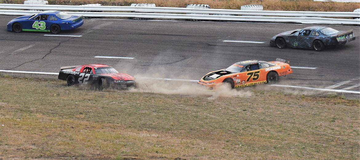 JD Undem (22) and Jon Davisson (75) head toward the infield during a turn 1 spinout. (Scot Heisel/Lake County Leader)